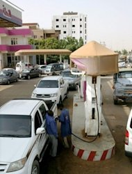 Sudanese queue in a petrol station to fuel their vehicles in the capital Khartoum on June 21. About 1,000 people were detained and hundreds injured -- many by tear gas -- during anti-regime protests in Sudan, an activist group told AFP on the anniversary of President Omar al-Bashir's (AFP Photo/Ashraf Shazly)