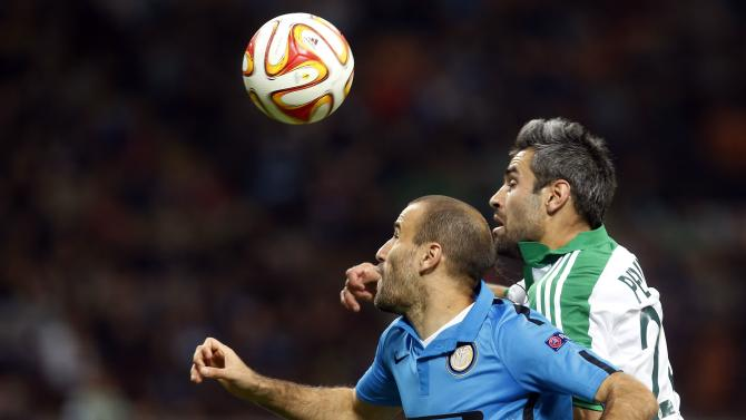 Inter Milan's Palacio fights for the ball with St Etienne's Perrin during their Europa League Group F soccer match in Milan