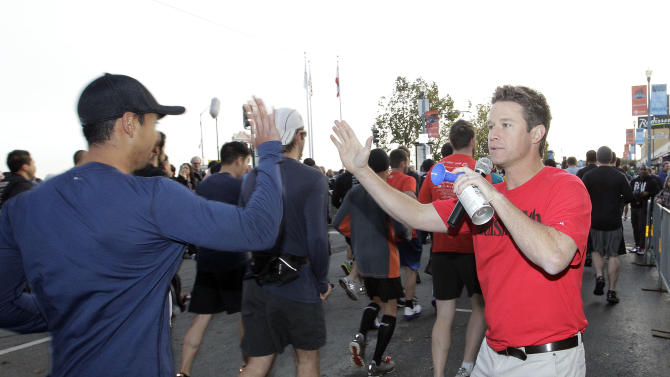 Celebrity host Billy Bush sounds a horn to signal the start of the Men's Health Urbanathlon, Sunday, November 18, 2012 in San Francisco. The Men's Health Urbanathlon is a rigorous 9 mile course, packed with challenging urban obstacles set against the backdrop of iconic city landmarks.(Photo by Tony Avelar/Invision for Men's Health/AP Images)
