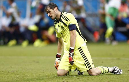 Spain's goalkeeper Iker Casillas reacts after a goal by Netherlands during their 2014 World Cup Group B soccer match at the Fonte Nova arena in Salvador