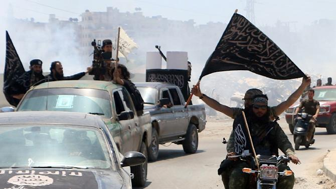 Fighters from Al-Qaeda's Syrian affiliate Al-Nusra Front drive through the northern Syrian city of Aleppo on May 26, 2015