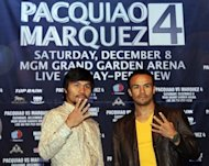 Boxers Juan Manuel Marquez, right, and Manny Pacquiao each hold up four fingers during a news conference in New York, Wednesday, Sept. 19, 2012. The boxers are promoting their fourth fight, scheduled for Dec. 8, 2012 in Las Vegas. (AP Photo/Seth Wenig)