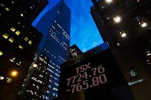A sign displaying TSX information is seen in Toronto