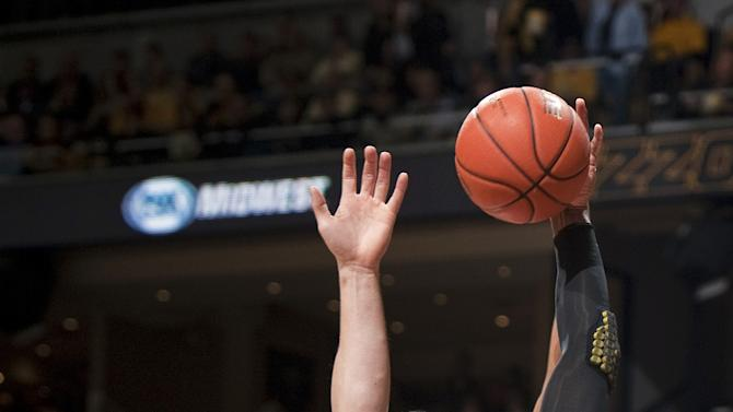 Missouri's Alex Oriakhi, right, pulls down a rebound in front of Vanderbilt's Shelby Moats, left, during the first half of an NCAA college basketball game Saturday, Jan. 26, 2013, in Columbia, Mo. (AP Photo/L.G. Patterson)
