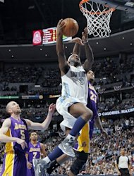 Denver Nuggets guard Ty Lawson, front, slides between Los Angeles Lakers guard Steve Blake, back left, and center Jordan Hill for a basket in the fourth quarter of the Nuggets&#39; 113-96 victory in Game 6 of the teams&#39;  first-round NBA basketball series in Denver on Thursday, May 10, 2012. (AP Photo/David Zalubowski)