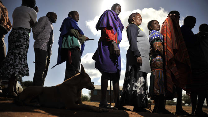 Masaai line up to vote in a general election in Ilbissil, Kenya, Monday March 4, 2013. Five years after more than 1,000 people were killed in election-related violence, Kenyans went to the polls on Monday to begin casting votes in the nationwide election seen as the country's most important - and complicated - in its 50-year history. (AP Photo/Riccardo Gangale)