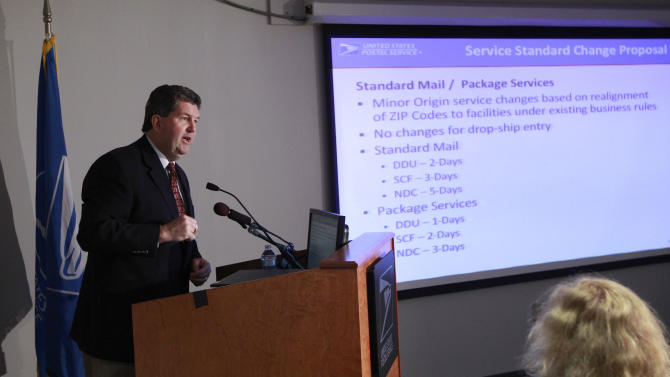 Postmaster General Pat Donahoe answers questions about cuts to First Class Mail service during a news conference in Washington, Monday, Dec. 5, 2011. (AP Photo/Charles Dharapak)
