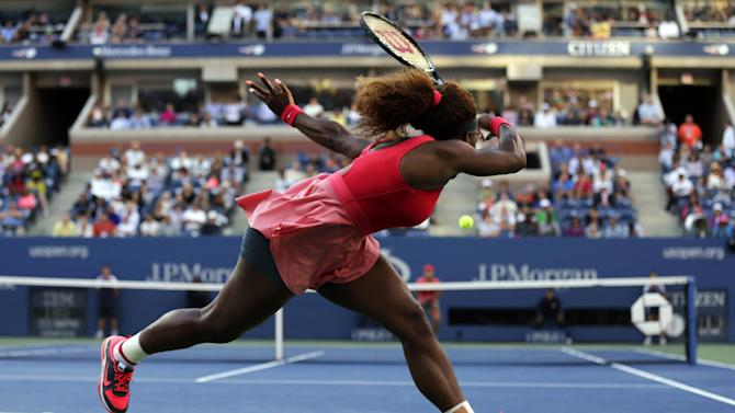 Serena Williams returns a shot against Li Na, of China, during the semifinals of the 2013 U.S. Open tennis tournament, Friday, Sept. 6, 2013, in New York. (AP Photo/Charles Krupa)
