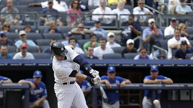 New York Yankees' Derek Jeter grounds out in the sixth inning of the baseball game against the Kansas City Royals at Yankee Stadium Thursday, July 11, 2013 in New York. Teammate Luis Cruz scored on the play. (AP Photo/Seth Wenig)