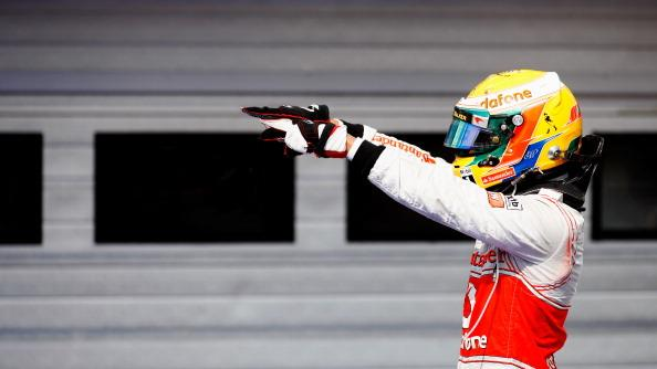 Lewis Hamilton of Great Britain and McLaren celebrates in parc ferme after finishing first during the Hungarian Formula One Grand Prix at the Hungaroring on July 29, 2012 in Budapest, Hungary. (Photo by Drew Gibson/Getty Images)