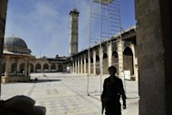 A Syrian rebel takes position at the Umayyad Mosque in the old city of Aleppo hours before the Syrian army retook control of the complex. Syria banned Turkish flights from its airspace on Sunday and Turkey made a similar tit-for-tat move, as regime forces pressed their counter-attack against rebels to regain territory lost in northern battlegrounds