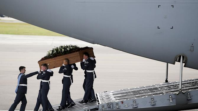 The coffin of Philip Heathcote is carried from an RAF C-17, which repatriated the bodies of nine British nationals killed by a gunman in an attack at the Tunisian beach resort of Sousse, in RAF Brize Norton