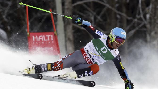 United States's Ted Ligety passes a gate during the first run of the men's giant slalom  at the Alpine skiing world championships in Schladming, Austria, Friday, Feb.15, 2013. (AP Photo/Luca Bruno)