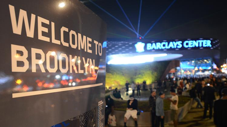 Music fans arrive for the first of eight Jay-Z shows which opened the Barclays Center in the Brooklyn borough of New York, Friday, Sept. 28, 2012. (AP Photo/Henny Ray Abrams)