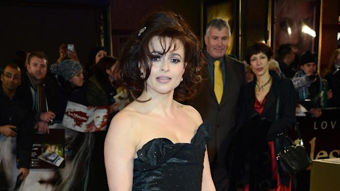 "FILE - In this Wed., Dec. 5, 2012 file photo, Helena Bonham Carter poses for photographers as she arrives at the film premiere of ""Les Miserables"" at a cinema in central London. A report from Ancestry.com says Victor Hugo was a political colleague of a cousin of the 46-year-old actress. Carter stars as Madame Thenardier in the upcoming musical ""Les Miserables."" (Photo by Jon Furniss/Invision/AP, File)"