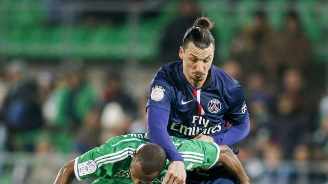 Theophile-Catherine of St Etienne challenges Ibrahimovic of Paris St Germain during their French Ligue 1 soccer match at the Geoffroy Guichard stadium in Saint-Etienne