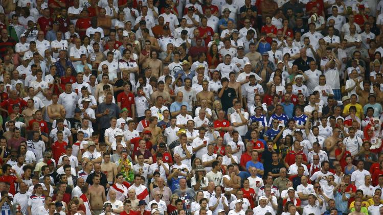 England fans react after Italy's Mario Balotelli scored past England's Joe Hart during World Cup soccer match at Amazonia arena