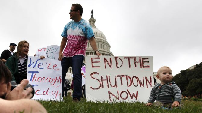 Federal workers demonstrate for an end to the U.S. government shutdown on the west front of the U.S. Capitol in Washington
