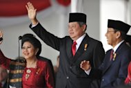 Indonesian President Susilo Bambang Yudhoyono waves during the country&#39;s 67th independence day celebration at the presidential palace in Jakarta on August 17. Yudhoyono has shown little action to match his rhetoric on fighting corruption, while his government has become mired in a bank bailout scandal and members of his Democratic Party have come under investigation in several cases