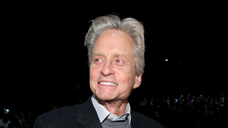 Michael Douglas attends the Fall 2013 Michael Kors Runway Show, on Wednesday, Feb. 13, 2013 in New York. (Photo by Dario Cantatore/Invision/AP)