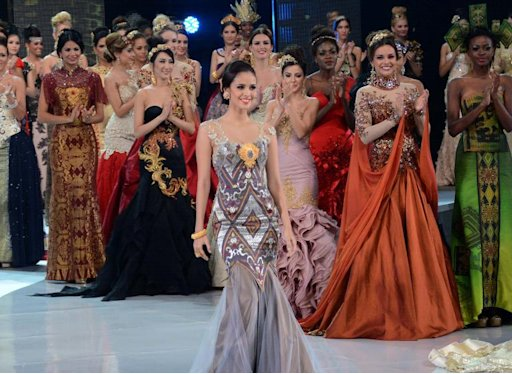 Miss Philippines Megan Young (C) is seen on the catwalk with other Miss World contestants in Nusa Dua, on the Indonesian island of Bali on September 24, 2013