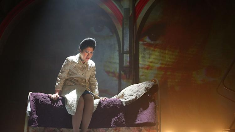 "This image released by The O and M Co. shows Ruthie Ann Miles as Imelda Marcos in ""Here Lies Love,"" with concept and lyrics by David Byrne, music by David Byrne and Fatboy Slim, at The Public Theater in New York. Byrne, the Talking Heads frontman went to the Philippines last week to add potential names to the English-based talent pool as he gears up to present the show in London this September. (AP Photo/The O and M Co., Joan Marcus)"