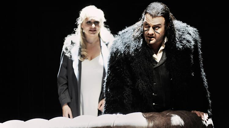 """In this undated photo provided by the Opernhaus Zurich Bryn Terfel in the role of the Hollaender (Dutchman), right, and Anja Kampe as Senta, left, perform on stage during a dress rehearsal for Richard Wagner's opera """"Der fliegende Hollaender"""" (The Flying Dutchman) at the opera in Zurich, Switzerland. (AP Photo/Opernhaus Zurich/T+T Fotografie/Toni Suter + Tanja Dorendorf)"""