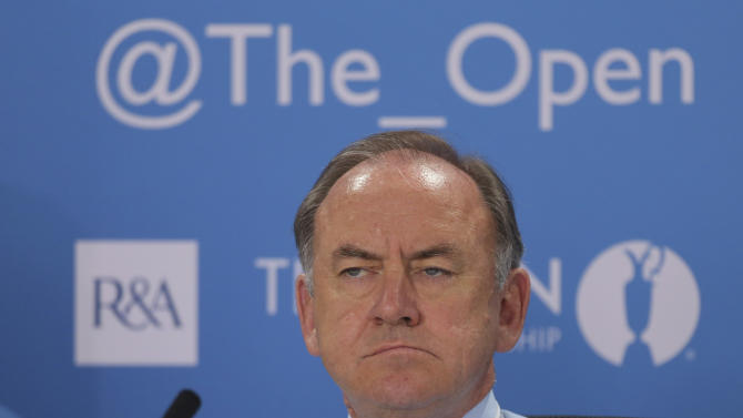 The Royal and Ancient Golf Club's Chief Executive Peter Dawson listens during a press conference ahead of the British Open Golf Championship at Muirfield, Scotland, Wednesday July 17, 2013. (AP Photo)
