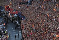 The Spanish national football team arrives on Cibeles Square after parading through Madrid, a day after it won the final match of the Euro 2012 championships 4-0 against Italy in Kiev