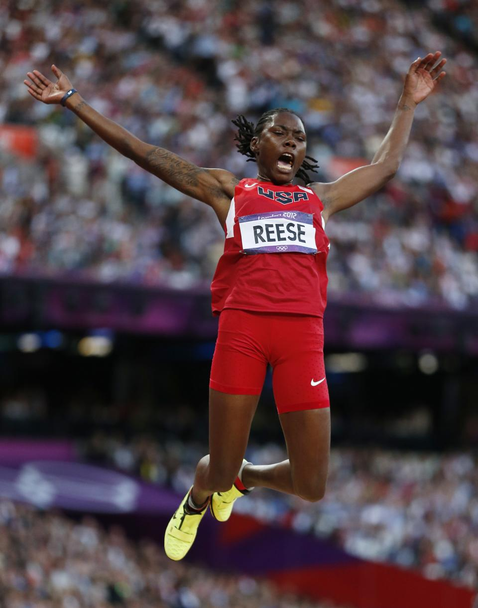 United States'  Brittney Reese competes in the women's long jump final during the athletics in the Olympic Stadium at the 2012 Summer Olympics, London, Wednesday, Aug. 8, 2012. (AP Photo/Matt Dunham)