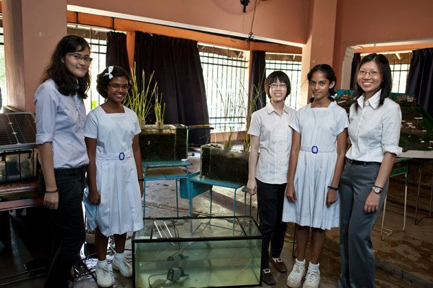 From left: Syahida Muhamad, Jocelyn Tay and Valencia Evelyn stand with two members of the Wetland Education Club at Mahayama Girls' College, with some of the wetland models they had built. (Photo courtesy of NTU)