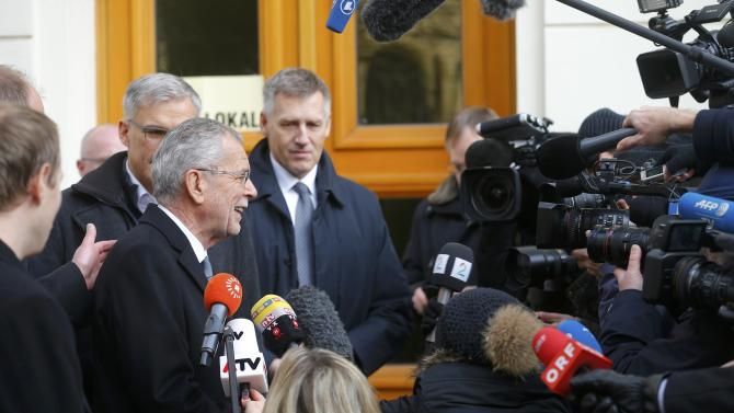 Austrian presidential candidate Van der Bellen, who is supported by the Greens, speaks to media in front of a polling station in Vienna