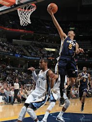 Utah Jazz guard Devin Harris (5) shoots above the defense of Memphis Grizzlies guard Mike Conley (11) in the first half of an NBA basketball game on Saturday, April 14, 2012, in Memphis, Tenn. (AP Photo/Nikki Boertman)