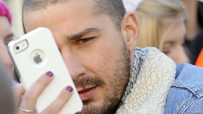 "Shia LaBeouf, a cast member in ""The Necessary Death of Charlie Countryman,"" poses for an iPhone photo on Main Street during the sixth day of the Sundance Film Festival, Tuesday, Jan. 22, 2013, in Park City, Utah. (Photo by Chris Pizzello/Invision/AP)"
