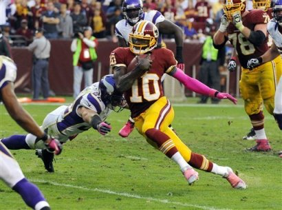 Redskins rookie QB Robert Griffin III enjoys contact, though he's learning to avoid it