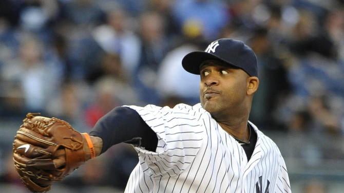 New York Yankees starting pitcher CC Sabathia winds up against the Seattle Mariners in the second inning of a baseball game at Yankee Stadium on Tuesday, May 14, 2013, in New York. (AP Photo/Kathy Kmonicek)