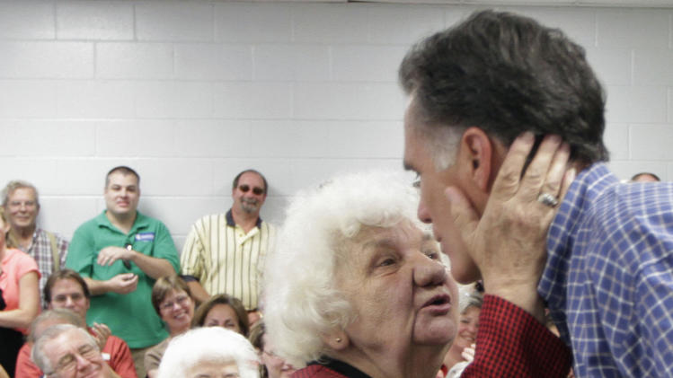 Republican presidential candidate, former Massachusetts Gov. Mitt Romney prepares to get a kiss from Lucie Opal following a town hall meeting at the cities Recreation Center in Keene, N.H., Wednesday, Aug. 24, 2011.  (AP Photo/Jim Cole)