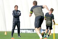Juventus coach Antonio Conte assesses his players during a training session on the eve of their Champions League match against Shakhtar Donetsk in Turin