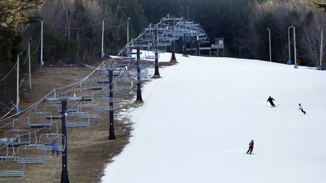 FILE - In this Jan. 5, 2012 file photo, man-made snow coats a ski run next to barren ground under a chairlift at Shawnee Peak ski area in Bridgton, Maine. Scientists point to both scant recent snowfall in parts of the country and this month's whopper of a Northeast blizzard as potential global warming signs. It may seem like a contradiction, but the explanation lies in atmospheric physics. (AP Photo/Robert F. Bukaty)