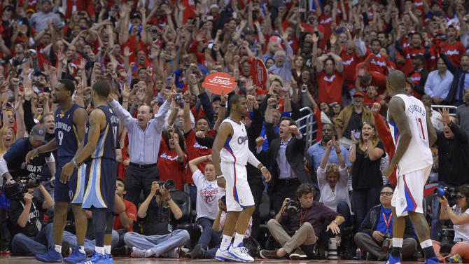 Fans celebrate after Los Angeles Clippers guard Chris Paul, center, hit a two-point shot with 0.1seconds left as guard Jamal Crawford, right, and Memphis Grizzlies guard Tony Allen, left, and guard Mike Conley look on during the second half of Game 2 of a first-round NBA basketball playoff series, Monday, April 22, 2013, in Los Angeles. The Clippers won 93-91. (AP Photo/Mark J. Terrill)