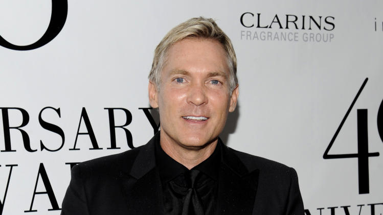"""FILE - This May 21, 2012 file photo shows Sam Champion at the FiFi Fragrance Awards at Alice Tully Hall in New York. Champion's new Weather Channel morning program, """"America's Morning Headquarters with Sam Champion,"""" or, for short, """"AMHQ,"""" which debuts March 17 will return him to the a.m. scene where he hailed as weather anchor on ABC's New York-based """"Good Morning America."""" (AP Photo/Evan Agostini, file)"""