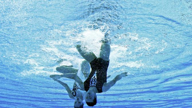 Abe and Adachi of Japan are seen underwater as they perform in the synchronised swimming mixed duet free routine preliminary at the Aquatics World Championships in Kazan