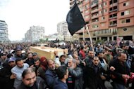<p>Mourners in the city of Port Said on January 28, 2013, carry the coffins of six people killed in clashes the day before. In Port Said, hundreds marched on a second day of funerals for those killed during confrontations.</p>