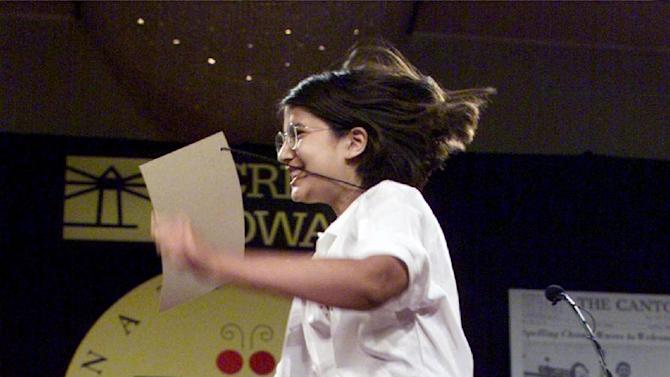 """FILE - In this June 3, 1999, file photo Nupur Lala, 14, from Tampa, Fla., reacts to winning the 72nd annual National Spelling Bee in Washington; she correctly spelled """"logorrhea.""""  Like all bee winners, she's since had to deal with the perks, drawbacks and stereotypes that come with the title — all magnified because she won the same year the competition was featured in an Oscar-nominated documentary.Today, she's 28 and finishing up a master's degree in cancer biology with plans to enroll in the University of Texas Medical School in Houston, having changed course from a career plan that had her researching memory and the brain for three years at MIT. (AP Photo/Ron Edmonds, File)"""