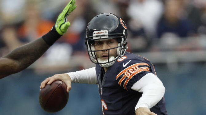 Chicago Bears quarterback Jay Cutler (6) passes against the Seattle Seahawks in the first half of an NFL football game in Chicago, Sunday, Dec. 2, 2012. (AP Photo/Nam Y. Huh)