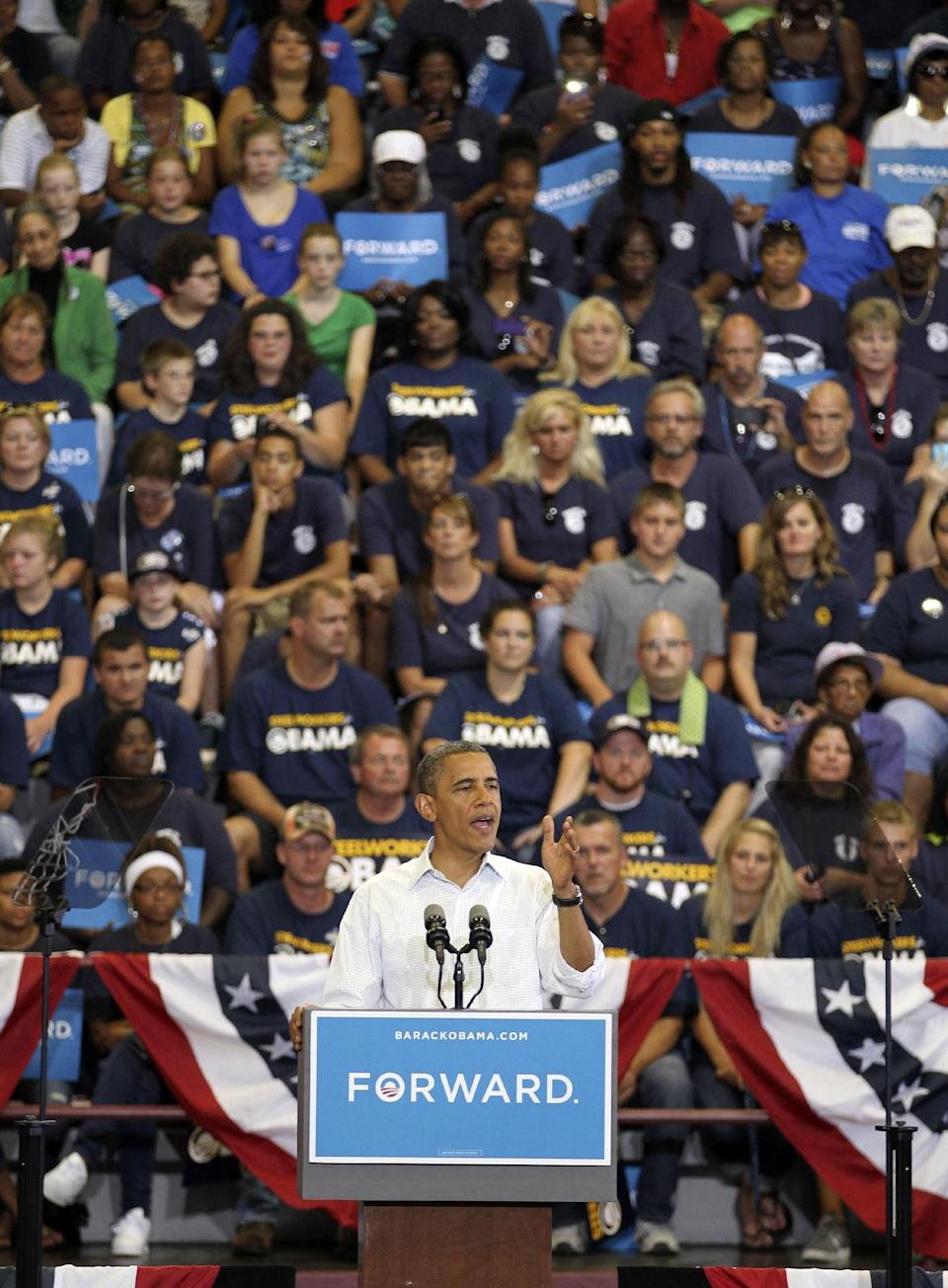 President Barack Obama speaks at a campaign event at Scott High School Monday, Sept. 3, 2012, in Toledo, Ohio. (AP Photo/Tony Dejak)