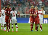Bayern Munich's Javier Martinez (3rd R) and Philipp Lahm celebrate winning their German first division Bundesliga match vs VFB Stuttgart, in Munich, southern Germany, on September 2. Bayern Munich host Mainz on Saturday looking for their third Bundesliga win of the season