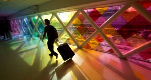 A lone traveler at the Miami International airport…