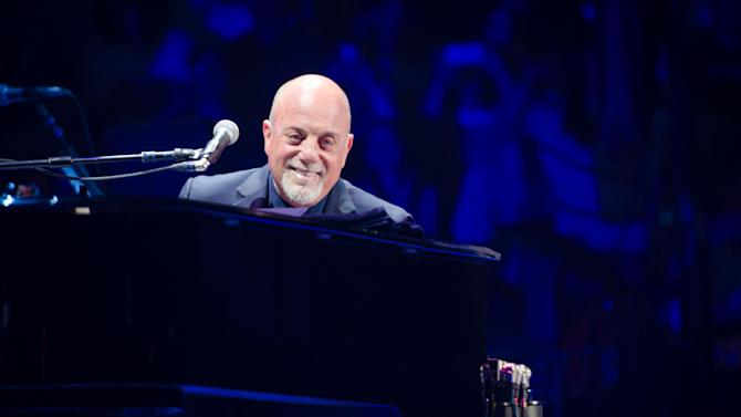 "FILE - In this May 9, 2014 file photo, Billy Joel performs at Madison Square Garden in New York. The Library of Congress on Tuesday, July 22, 2014 said Joel, whose hits include ""Piano Man"" and ""Uptown Girl,"" will receive its Gershwin Prize for Popular Song. (Photo by Scott Roth/Invision/AP, File)"