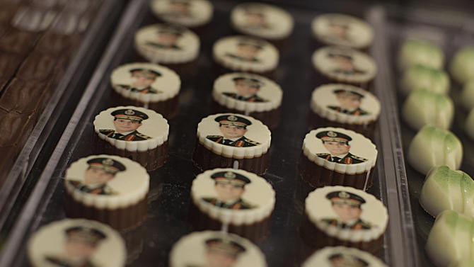 FILE - This Sept. 14, 2013, file photo shows chocolates decorated with pictures of Egyptian Defense Minister Gen. Abdel-Fattah el-Sissi displayed for sale in a shop in Cairo. Egypt's military chief is looking for a strong turnout in next week's nationwide constitutional referendum as a mandate on whether he should run for president, senior officials tell the AP. The popular general who ousted President Mohammed Morsi and ordered a crackdown on the Muslim Brotherhood could be disappointed as his Islamist foes have promised a boycott and mass demonstrations raising fears of violence that are likely to keep voters at home.(AP Photo/Khalil Hamra, File)